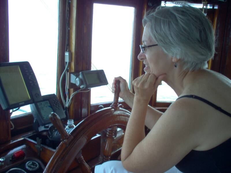 Oyster Buyboat PropWash, Brenda at Helm.jpg